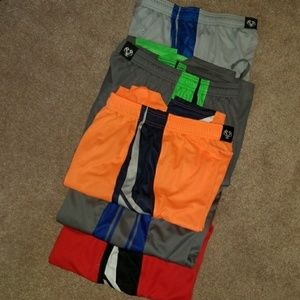 Lot of 5/under armour shorts.Youth Large